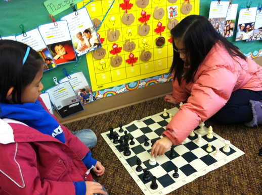 Kids learning chess at school